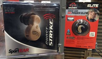 Hearing enhancement devices are displayed at a hunting store Thursday, June 1, 2017, in Scarborough, Maine. The group Guns Owners of America says a push by Sens. Elizabeth Warren and Susan Collins to get more hearing aids to people is not about hearing aids at all. They says it's a covert attempt to get more regulation of firearm products such as hearing enhancement devices used by hunters. (AP Photo/Robert F. Bukaty)