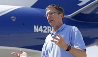 In this photo taken Friday, May 12, 2017, National Hurricane Center Director Dr. Rick Knabb talks to a reporter, at the U.S. Coast Guard Air Station Miami, at the Miami-Opa Locka Executive Airport, in Opa-locka, Fla. On his last day as hurricane center director before returning to The Weather Channel, Knabb said better data and better computer models help create in narrower cone. A narrower cone gets more and more useless for telling you where the impacts of wind and water are going to be. (AP Photo/Alan Diaz)