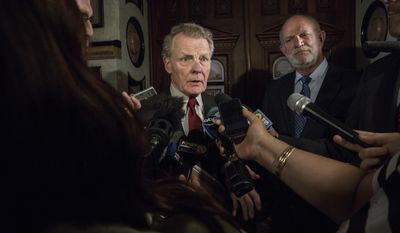 Speaker of the House, Michael J. Madigan talks to press as he leaves after Democratic Caucus at the Illinois General Assembly in session at the Capitol in Springfield, Ill., Wednesday, May 31, 2017. Madigan's spokesperson Steve Brown is on the right. (Zbigniew Bzdak/Chicago Tribune via AP)