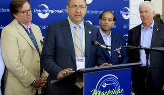 State Sen. Tony Stamas, a Midland Republican, urges the Michigan House to pass economic development tax incentives on Thursday, June 1, 2017, at the Detroit Regional Chamber's Mackinac Policy Conference on Mackinac Island, Mich. Also pictured are Oakland County Deputy Executive Matt Gibb, left, Detroit Regional Chamber President and CEO Sandy Baruah and Gov. Rick Snyder. (AP Photo/David Eggert)