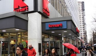 FILE- In this Dec. 27, 2011, file photo, pedestrians pass a Kmart location in New York. Sears Holdings Corp. says some of its Kmart stores were targeted by hackers, leading to unauthorized activity on some of its customers' credit cards. The company says in a blog post that Kmart's store payment systems were infected with virus-like computer code undetectable by current anti-virus systems. (AP Photo/Frank Franklin II, File)