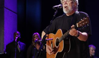 "FILE - In this Oct. 21, 2012, file photo, Bob Seger performs at the Country Music Hall of Fame Inductions in Nashville, Tenn. Seger announced his ""Runaway Train"" tour set for late summer and fall of 2017 on June 1, 2017. (Photo by Wade Payne/Invision/AP, File)"