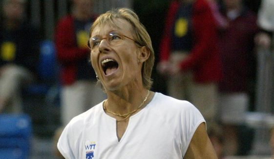 In this July 10, 2003, file photo, Martina Navratilova of the Philadelphia Freedoms reacts after a shot in her team tennis match against Hartford Fox-Force, in Radnor, Pa. (AP Photo/Rusty Kennedy, File)