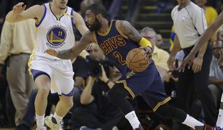 Cleveland Cavaliers guard Kyrie Irving (2) drives against Golden State Warriors guard Klay Thompson (11) during the first half of Game 1 of basketball's NBA Finals in Oakland, Calif., Thursday, June 1, 2017. (AP Photo/Marcio Jose Sanchez)