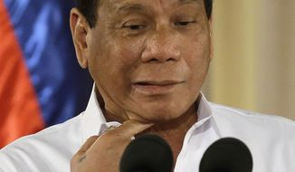 Philippine President Rodrigo Duterte gestures during his speech at the swearing in of municiple at the Malacanang presidential palace in Manila, Philippines on Thursday, June 1, 2017. (AP Photo/Aaron Favila) ** FILE **