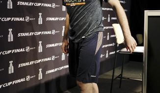 Injured Nashville Predators center Ryan Johansen walks off the stage after answering questions at a news conference Thursday, June 1, 2017, in Nashville, Tenn. The Predators and Pittsburgh Penguins are scheduled to play Game 3 of the NHL hockey Stanley Cup Finals Saturday, June 3. (AP Photo/Mark Humphrey)