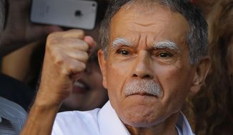 FILE - In this Thursday, May 18, 2017 file photo, Puerto Rican nationalist Oscar Lopez Rivera reacts to the crowd at a gathering in his honor in Chicago's Humboldt Park neighborhood. New York City's mayor Bill de Blasio says Thursday, June 1, 2017, Rivera recently freed from prison has agreed to step aside from any formal role in the city's Puerto Rican Day parade. Parade organizers had planned to honor Rivera, a member of the Armed Forces of National Liberation, or FALN, which claimed responsibility for more than 100 bombings in the 1970s and 1980s. (AP Photo/Charles Rex Arbogast, File)