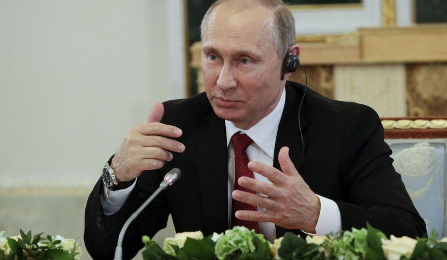 Russian President Vladimir Putin speaks at a meeting with heads of international news agencies at the St. Petersburg International Economic Forum in St. Petersburg, Russia, Thursday, June 1, 2017. (AP Photo/Dmitri Lovetsky)