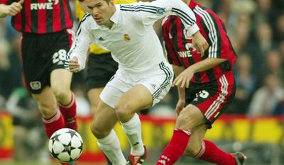 FILE - In this Wednesday May 15, 2002 file photo, Real Madrid's Zinedine Zidane in action during the Champions League Final against Bayer Leverkusen at Hampden Park in Glasgow, Scotland. Real Madrid won the match 2-1 with Zidane scoring the winner to claim its ninth title. On Saturday, June 3, 2017 Real Madrid will be looking to win its 12th title when it plays Juventus at the Millennium Stadium in Cardiff, Wales. (AP Photo/Frank Augstein, File)