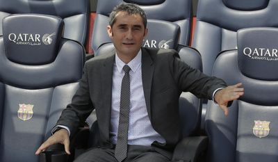 FC Barcelona's new signing coach Ernesto Valverde gestures during his official presentation at the Camp Nou stadium in Barcelona, Spain, Thursday, June 1, 2017. Former player Valverde was hired as the new coach, the club confirmed on Monday. (AP Photo/Manu Fernandez)