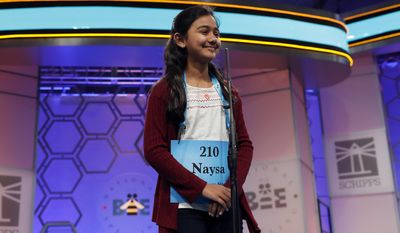 Naysa Modi, 11, from Monroe, La., spells her word during the 90th Scripps National Spelling Bee, Thursday, June 1, 2017, in Oxon Hill, Md. (AP Photo/Alex Brandon)