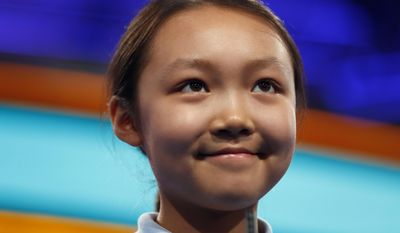 Alice Liu, 10, from Chesterfield, Mo., smiles before spelling her word during the 90th Scripps National Spelling Bee, Thursday, June 1, 2017, in Oxon Hill, Md. (AP Photo/Alex Brandon)