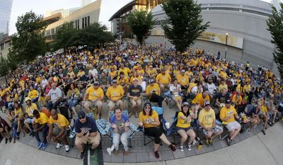 Nashville Predators fans watch the Predators play the Pittsburgh Penguins in Game 1 of the NHL Stanley Cup Finals at a viewing areas set up across the street from Bridgestone Arena Monday, May 29, 2017, in Nashville, Tenn. (AP Photo/Mark Humphrey)