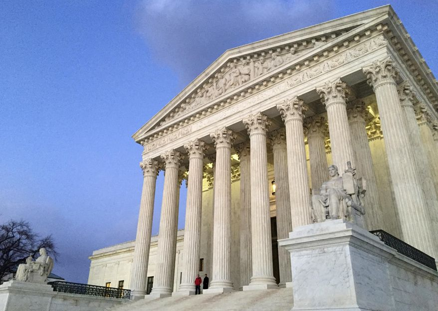 In this Feb. 13, 2016, file photo, people stand on the steps of the Supreme Court at sunset in Washington. The Trump administration made a plea to the Supreme Court on June 1, 2017, to let the travel ban take effect. (AP Photo/Jon Elswick, file)