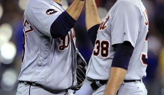 Detroit Tigers right fielder J.D. Martinez, left, and relief pitcher Justin Wilson celebrate following the team's baseball game against the Kansas City Royals at Kauffman Stadium in Kansas City, Mo., Wednesday, May 31, 2017. The Tigers defeated the Royals 6-5. (AP Photo/Orlin Wagner)