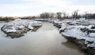 FILE - In this Feb. 14, 2017 file photo, ice that began to break up overnight shows the clearing on the Bighorn river near Worland, Wyo. Relatively minor flooding occurred in Wyoming during May from melting snow, but water experts caution residents along rivers and streams not to become complacent because the mountain snowpack remains exceptionally deep in many places and the main runoff is expected to be prolonged this year. (Karla Pomeroy/Northern Wyoming Daily News via AP, File)