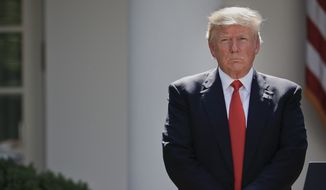 President Donald Trump stands next to the podium after speaking about the U.S. role in the Paris climate change accord, Thursday, June 1, 2017, in the Rose Garden of the White House in Washington. (AP Photo/Pablo Martinez Monsivais)