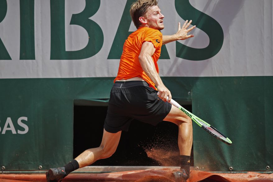 Belgium's David Goffin twists his right ankle in his match against Argentina's Horacio Zeballos during their third round match of the French Open tennis tournament at the Roland Garros stadium, in Paris, France. Friday, June 2, 2017. Goffin's injury forced him to give up. (AP Photo/Christophe Ena)