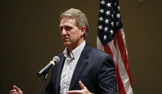Sen. Jeff Flake, R-Ariz., speaks to members of the Glendale Chamber of Commerce Tuesday, May 30, 2017, in Glendale, Ariz. (AP Photo/Ross D. Franklin) ** FILE **