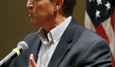 Sen. Jeff Flake, R-Ariz., answers a question as he speaks to members of the Glendale Chamber of Commerce Tuesday, May 30, 2017, in Glendale, Ariz. (AP Photo/Ross D. Franklin)