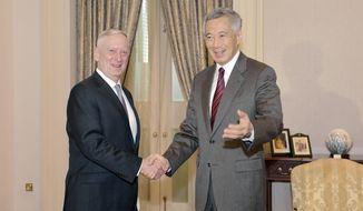 Singapore's Prime Minister Lee Hsien Loong, right, meets U.S. Defense Secretary Jim Mattis, for a bilateral meeting at the Istana or Presidential Palace in Singapore on Friday, June 2, 2017. On Friday Mattis indicated that the Trump administration is aiming for continuity in Asia policy, sticking broadly with the approach its predecessors have taken by emphasizing diplomacy and cooperation with allies. (AP Photo/Joseph Nair)