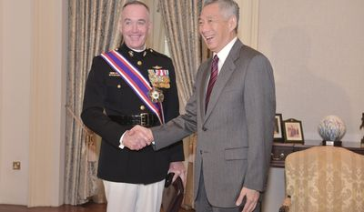 Singapore's Prime Minister Lee Hsien Loong, right, meets U.S. Joint Chiefs Chairman Gen. Joseph Dunford Jr., for a bilateral meeting at the Istana or Presidential Palace in Singapore on Friday, June 2, 2017. (AP Photo/Joseph Nair)