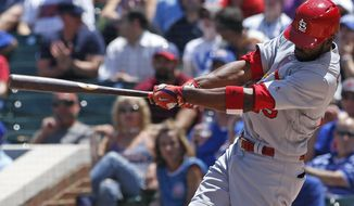 St. Louis Cardinals' Dexter Fowler hits a solo home run against the Chicago Cubs during the first inning of a baseball game Friday, June 2, 2017, in Chicago. (AP Photo/Nam Y. Huh)
