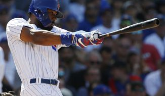 Chicago Cubs' Jason Heyward hits a sacrifice fly during the eighth inning of a baseball game against the St. Louis Cardinals, Friday, June 2, 2017, in Chicago. (AP Photo/Nam Y. Huh)