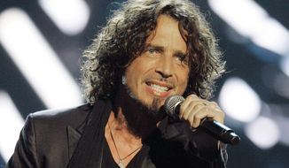 FILE - In this Sept. 5, 2008, file photo, musician Chris Cornell performs on stage during Conde Nast's Fashion Rocks show in New York. Autopsy reports show Cornell had sedatives and an anxiety drug in his system on the night he died by hanging himself in his Detroit hotel room. The reports released Friday, June 2, 2017, by the Wayne County medical examiner, two weeks after Cornell was found dead, say the drugs didn't contribute to the cause of death but don't elaborate.  (AP Photo/Jeff Christensen, File)