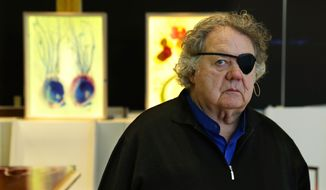 In this March 22, 2017 photo, glass artist Dale Chihuly poses for a photo in one of his studios in Seattle. Chihuly is a pioneer of the glass art movement and is internationally known for styles that include vibrant seashell-like shapes and ambitious installations in botanical gardens and museums. He lost sight in his left eye in a 1976 car crash.  (AP Photo/Ted S. Warren)