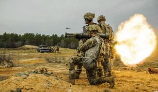 In this March 22, 2017 photo, soldiers with 1st Brigade Combat Team, 82nd Airborne Division fire single-use AT-4 rockets during a live fire training exercise on Fort Bragg, N.C. The training was in preparation for a coming deployment to Afghanistan. (Shane Dunlap /The Fayetteville Observer via AP)