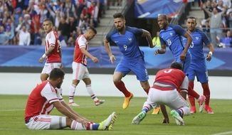 Olivier Giroud of France, center, jubilates as he scores the first goal against Paraguay during their friendly soccer match, in Rennes, western France, Friday, June 2, 2017. (AP Photo/David Vincent)