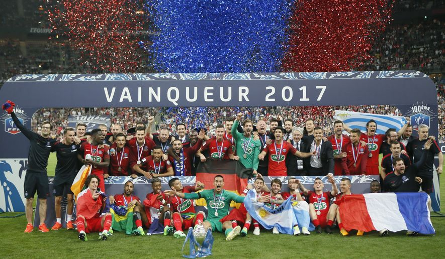 Paris Saint-Germain's team celebrates with their trophy after winning the French Cup 2017 Final soccer match, between Paris Saint-Germain (PSG) and Angers at Stade de France in Saint Denis, north of Paris, France, Saturday, May 27, 2017. (AP Photo/Francois Mori)