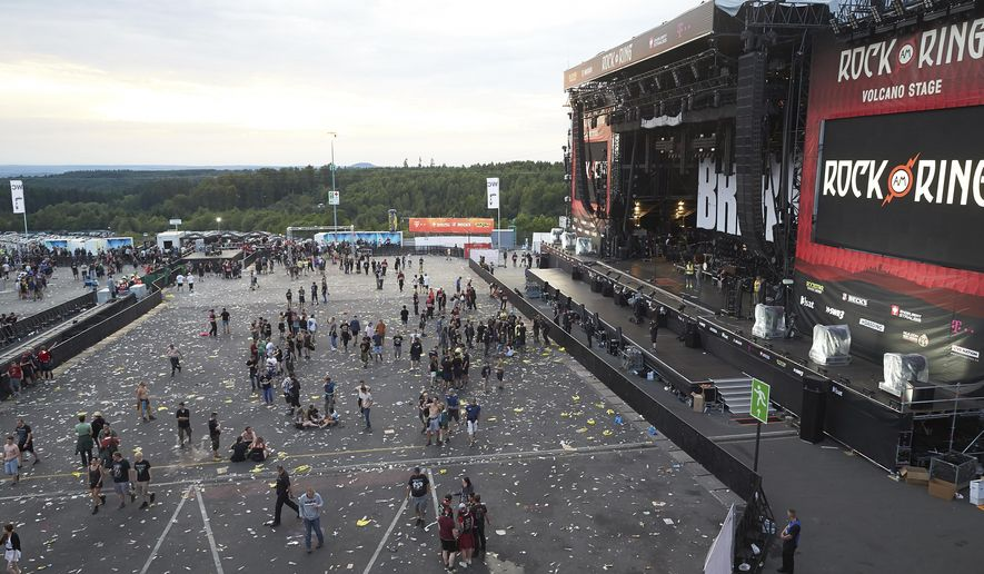 Visitors leave the music festival Rock am Ring outside the western town of Nuerburg, Germany, Friday, June 2, 2017. German authorities have shut down a popular music festival after uncovering a possible terrorist threat. (Thomas Frey/Dpa via AP)