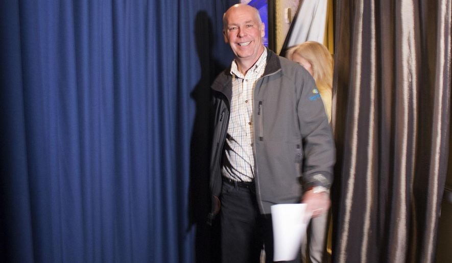 FILE - In this May 25, 2017 file photo, Republican Greg Gianforte prepares to go onstage at a hotel ballroom in Bozeman, Mont. to thank supporters after winning Montana's sole congressional seat. Press groups are asking the Office of Congressional Ethics to look into possible disciplinary measures against Gianforte, who faces a misdemeanor assault charge in connection to an election eve confrontation with a reporter, Friday, June 2, 2017. The Republican has yet to appear in court to face the charge filed against him. (AP Photo/Bobby Caina Calvan, File)