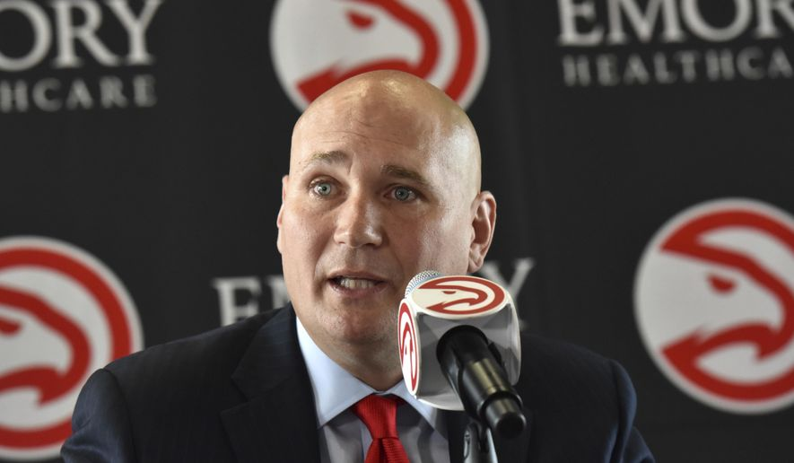 Atlanta Hawks new general manager Travis Schlenk speaks  during an introductory press conference at Philips Arena in Atlanta, Friday, June 2, 2017. (Hyosub Shin/Atlanta Journal-Constitution via AP)