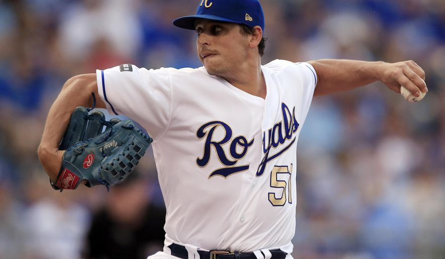 Kansas City Royals starting pitcher Jason Vargas delivers to a Cleveland Indians batter during the first inning of a baseball game at Kauffman Stadium in Kansas City, Mo., Friday, June 2, 2017. (AP Photo/Orlin Wagner)