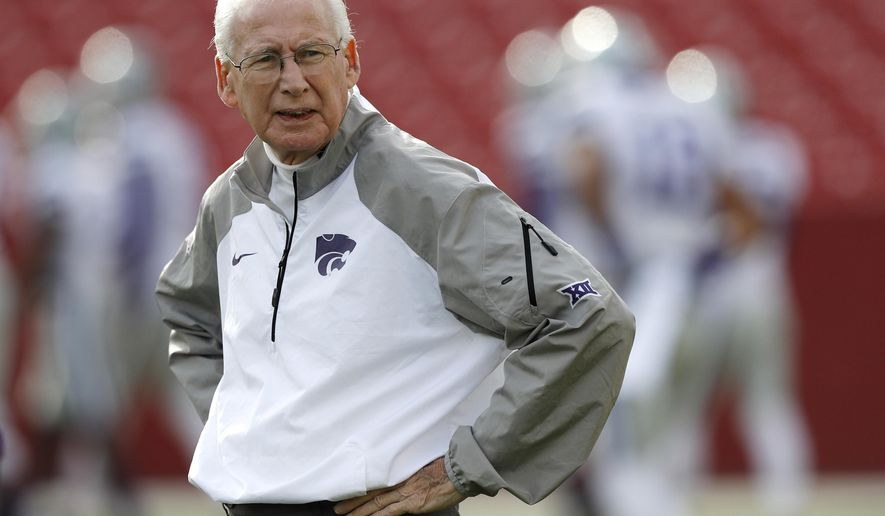 FILE - In this Oct. 29, 2016, file photo, Kansas State coach Bill Snyder stands on the field before the team's NCAA college football game against Iowa State in Ames, Iowa. Kansas State coach Bill Snyder is defending his choice not to grant a wide receiver a release from his scholarship, a decision that has sparked controversy around his program. Corey Sutton announced his desire to transfer, claiming Snyder did not follow through on certain promises of playing time. Snyder said Thursday night, June 1, 2017, that his view is that players make a commitment to the program when they sign a national letter of intent, just as the program makes a commitment to them with a scholarship.(AP Photo/Charlie Neibergall, File)