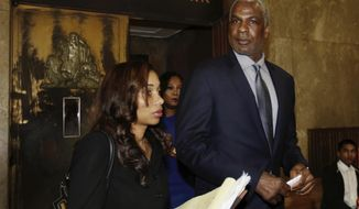 FILE - In this April 11, 2017, file photo, former New York Knicks player Charles Oakley leaves Manhattan Criminal Court, in New York. Oakley has chosen to go to trial in August on charges he struck a security guard at Madison Square Garden. Oakley appeared briefly before a Manhattan judge on Friday, June 2, 2017. He rejected a conditional dismissal that would have left him with a clean record after six months of good behavior. (AP Photo/Richard Drew, File)