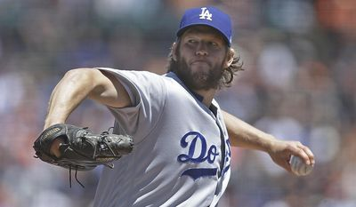 FILE - In this May 17, 2017, file photo, Los Angeles Dodgers pitcher Clayton Kershaw works against the San Francisco Giants during a baseball game in San Francisco. Kershaw (7-2) starts Friday's series opener for the Dodgers against Milwaukee, where he is 4-0 with a 1.41 ERA in five starts. (AP Photo/Ben Margot, File)