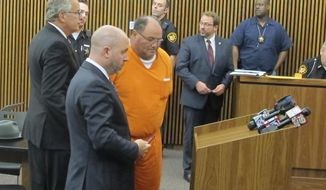 "FILE - In this July 17, 2015, file photo, Carmine ""The Bull"" Agnello of Bentleyville, Ohio, is escorted into court in Cleveland.  Agnello, a reputed member of the Gambino crime family and former son-in-law of John Gotti agreed Thursday, June 1, 2017, to a plea deal to avoid prison in what authorities originally said was a multi-million dollar scam involving stolen cars and scrap metal in Cleveland.  (Ida Lieszkovszky /The Plain Dealer via AP, File)"