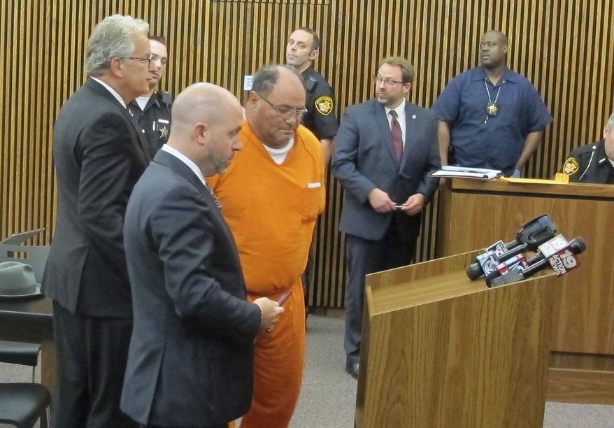 """FILE - In this July 17, 2015, file photo, Carmine """"The Bull"""" Agnello of Bentleyville, Ohio, is escorted into court in Cleveland.  Agnello, a reputed member of the Gambino crime family and former son-in-law of John Gotti agreed Thursday, June 1, 2017, to a plea deal to avoid prison in what authorities originally said was a multi-million dollar scam involving stolen cars and scrap metal in Cleveland.  (Ida Lieszkovszky /The Plain Dealer via AP, File)"""
