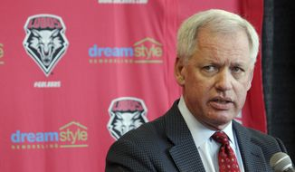 FILE--In this May 3, 2017, file photo, University of New Mexico athletics director Paul Krebs answers questions during a news conference in Albuquerque, N.M. Krebs is announcing his retirement, a move that comes amid criticism over spending by the athletics department. A statement released Friday, June 2, 2017, by the university says Krebs will retire June 30, 2017. (AP Photo/Susan Montoya Bryan, File)