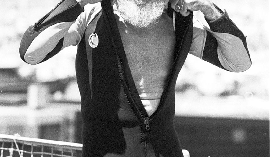 In this August 5, 1982 photo, Jack O'Neill suits up in the small craft harbor before windsurfing off Santa Cruz, Calif. A California surfing world icon who pioneered the wetsuit has died. O'Neill's family says he died Friday, June 2, 2017, at home of natural causes. He was 94. (Dan Coyro/The Santa Cruz Sentinel via AP)