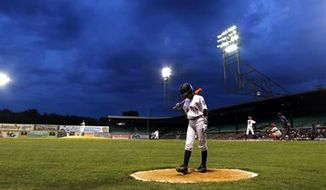 FILE - In this June 24, 2015, file photo, Mo'ne Davis, of the Anderson Monarchs, gets ready to bat against the Willie Mays RBI Birmingham team at Rickwood Field,  in Birmingham, Ala. The field is the oldest ballpark in America but it requires at least a half-million dollars in repairs to get it back in playing shape. (AP Photo/Butch Dill, File)