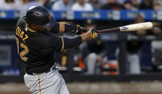 Pittsburgh Pirates' Elias Diaz (32) connects for a three-run double against the New York Mets during the fourth inning of a baseball game, Friday, June 2, 2017, in New York. (AP Photo/Julie Jacobson)
