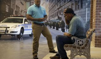 FILE- In this Sept. 2, 2015 file photo, New York City Police Officer Lamont Edwards talks to actor Nathan Purdee during a Crisis Intervention Training class at the New York Police Department Police Academy, in New York. Even before an encounter between a schizophrenic woman and a police sergeant in October 2016 left her dead and him now facing a murder charge, NYPD officials realized the need for officers to better understand how to manage mental illness, and created a specialized training. (AP Photo/Mary Altaffer, File)