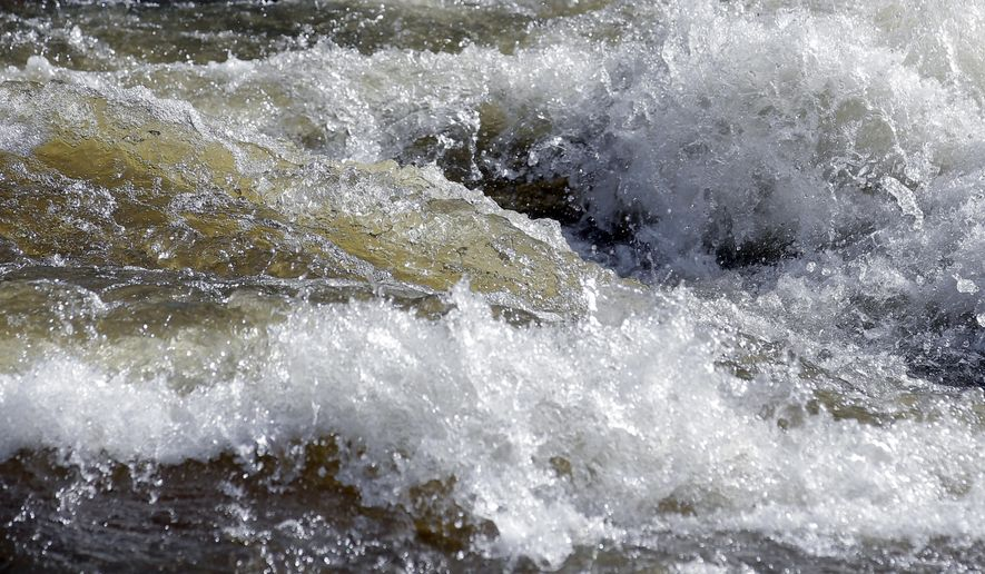 In this Wednesday, May 31, 2017, photo, fast-flowing water races down the Weber River, in Oakley, Utah. Authorities in Utah are ratcheting up warnings telling people to stay away from the raging, icy waterways that are extremely dangerous this spring due to a snowy winter and wet spring. (AP Photo/Rick Bowmer)