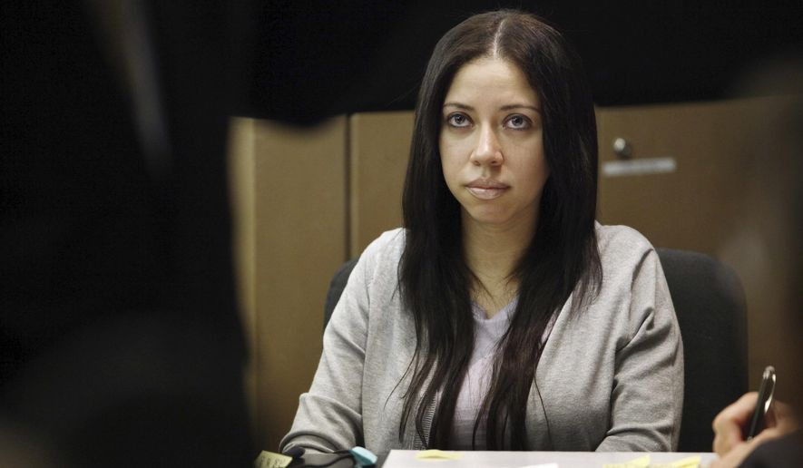 FILE - In this Tuesday, April 26, 2011 file photo, Dalia Dippolito watches during jury selection in her trial at the Palm Beach County Courthouse in West Palm Beach, Fla. The third trial of Dippolito, a former Florida escort accused of soliciting a hitman to kill her newlywed husband is under way, Friday, June 2, 2017. (AP Photo/ Richard Graulich, Pool, File)