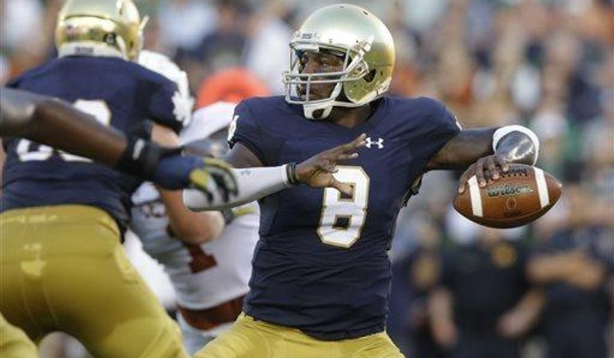 FILE - In this Sept. 5, 2015, file photo, Notre Dame quarterback Malik Zaire looks to a pass during the first half of an NCAA college football game against Texas, in South Bend, Ind. The Southeastern Conference tweaked its graduate transfer policy Friday, June 2, 2017, making changes that would allow former Notre Dame quarterback Zaire to land at Florida. (AP Photo/Nam Y. Huh, File)